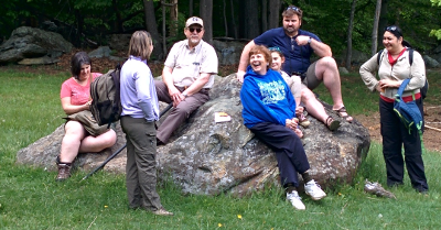 Adults sitting on a rock and being boring