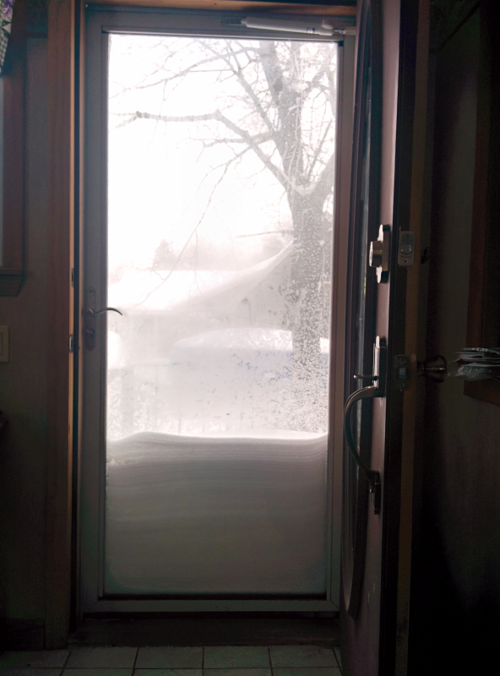snow piled up on our door