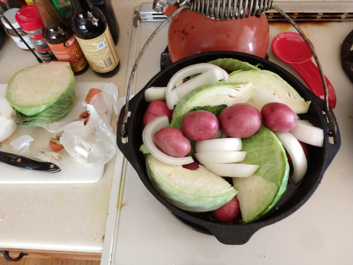 dutch oven with corned beef and vegetables